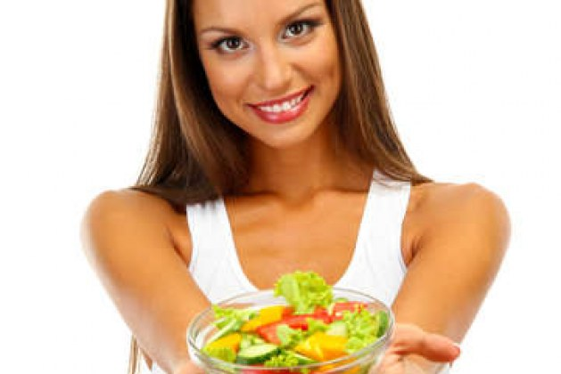 16546347-beautiful-young-woman-with-salad-isolated-on-white