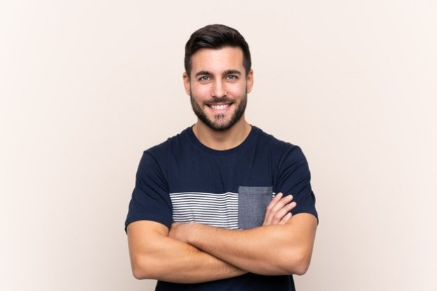 young-handsome-man-with-beard-isolated-keeping-arms-crossed-frontal-position_1368-132662
